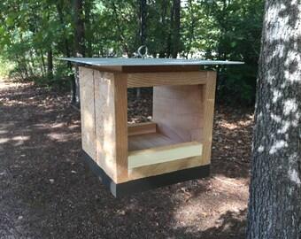 Modern bird feeder in natural cedar with aluminum roof and espresso-brown accent. Backyard, patio, or deck bird feeder for small birds.