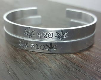 420 - 710 hand stamped cuff bracelet with cannabis leaves, handmade by the toke shop