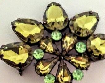 Vintage hematite and green rhinestone brooch.
