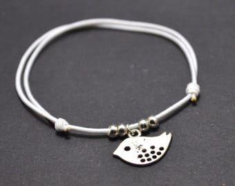 Bird white cord bracelet