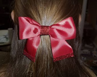 red bow with glitter accents