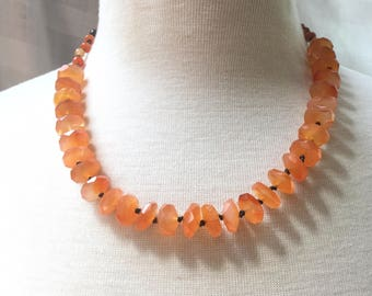 Carnelian and red agate knotted leather necklace with copper clasp