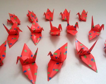 Set of confetti origami cranes