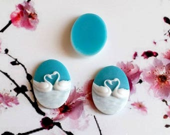 14, 25x18mm cameos, resin, white swans on a hard blue