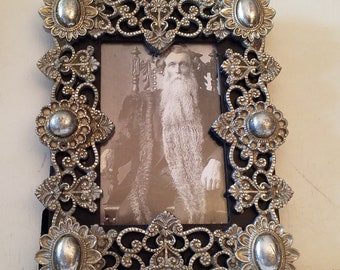 Ornate metal look frame with glass, without picture