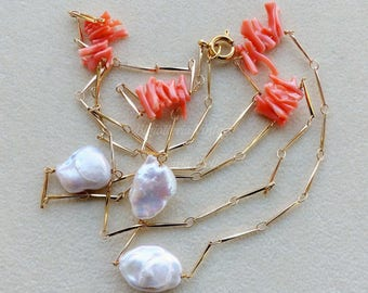Gold plated necklace embellished by salmon pink coral branches