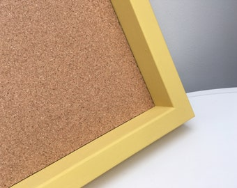 Framed pin board with yellow frame.  Large cork board with box frame. Noticeboard with solid wood frame painted any colour you want.