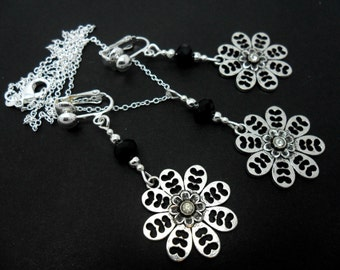 A hand made tibetan silver  flowers necklace and clip on earring set.