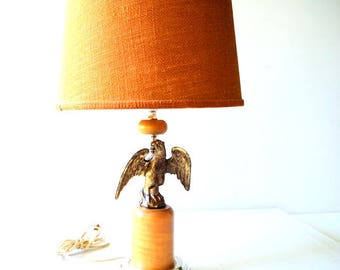 Americana vintage 60s , brass  american eagle , table lamp with a burlap shade.