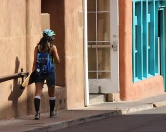 Southwestern Skateboarder, fine art photo, color photograph, whimsy photography, Sante Fe, landscape photography, adobe building