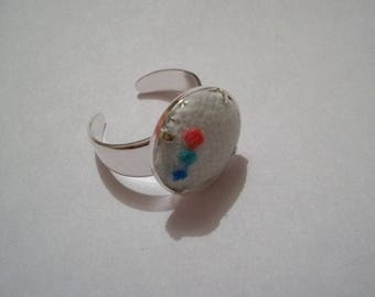 White fishnet stockings and red green blue diamond ring