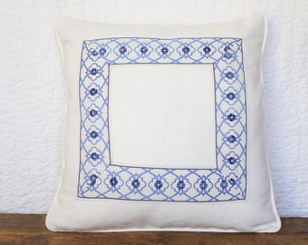 Ivory pillow cover with blue trim