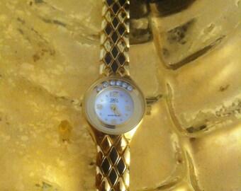 Xmas : gold ( overgolde )24ct. braceletclock, un used, 80s/ 90s