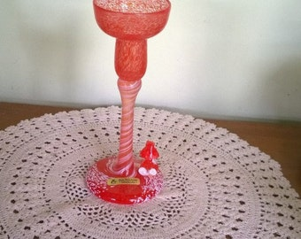 Jan Stievens red & white mottled art glass candle holder with gnome character on base signed