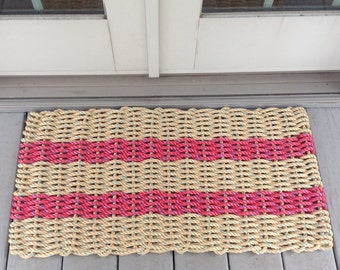 Tan and red handwoven doormat from lobster trap rope.