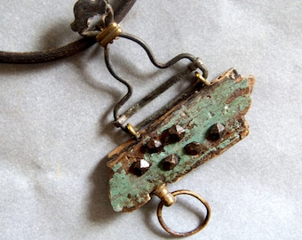Necklace, found objects: Driftwood, suspenders, antique nails, sewing machines belts, watches part