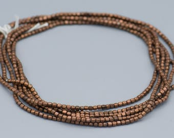 """Antique Copper Bead - 2x3mm - Small Rounded Cube - 210 Beads 24"""" Strand SKU-MRR2X3AC-85"""