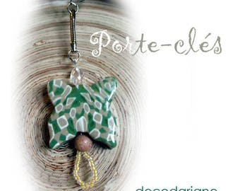 Key chain in silver with butterfly polymer clay and seed beads