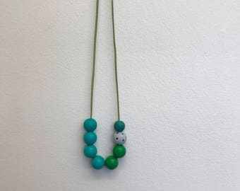 hand painted wooden bead necklace: turquoises and greens.