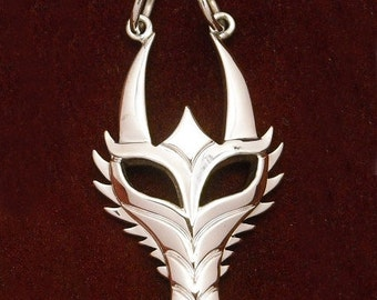 Spiney dragon mask pendant - sterling silver
