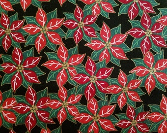 Red Poinsettias on Black Cotton Fabric sold by the yard