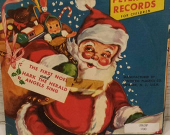 Vintage Peter Pan Records Rudolf, 1st Noel, Hark the Herald Mfg by Synthetic Plastics Co NJ. Red Vinyl 45 RPM. Sleeve nice cond. Record VG