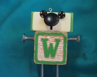 "Mini Bot, letter ""W"", mixed media robot sculpture"