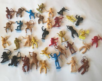 Vintage lot of 36 cowboys and indians figures. Worh a knight or two thrown in. Miniatures.