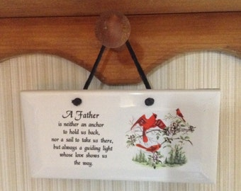 Ceramic Plaque  it is 3 by 6. With A father  saying