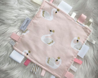 taggy blanket. Security blanket. Baby taggy.baby gift.sensory blanket. Baby toy. Ribbon tags.minky back. Pink and gold.Swan taggy.baby girl