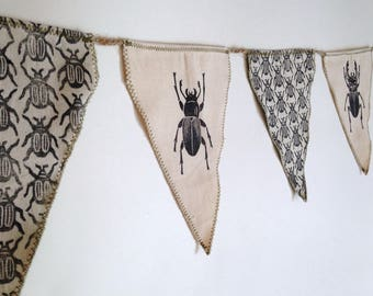 Beetle bunting. Hand printed and hand sewn.