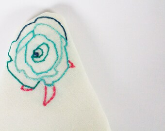 Hand embroidered scarf with linen flower design