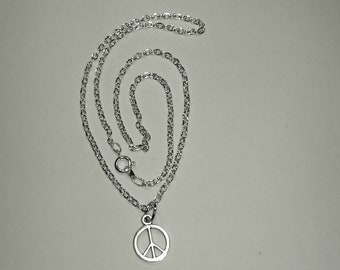 Sterling silver necklace with a peace sign pendant.