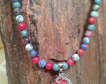 Multi-colored howlite dragon pendant necklace with multi colored howlite beads
