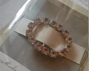 We have here, an adorable, vintage rhinestone buckle. I bought a tin full of sewing what nots on auction, and I found buried treasure!