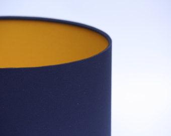 Indigo blue cotton fabric drum lampshade with contrasting mustard cotton fabric lining