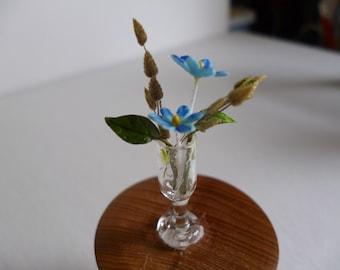 One 12th scale Miniature Flowers in a vase .