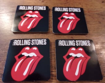 set of 4 brand new   ROLLING STONES  Tongue  drink coasters.