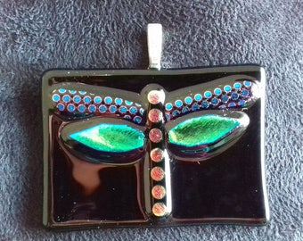 Unique fused and dichroic glass dragonfly pendant.