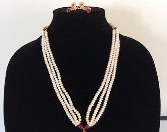Nizami natural pearls pendant set with earrings in rubies , jugni set