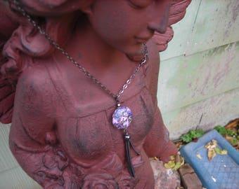 Lavender and gunmetal tassel pendant.