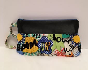AK15- Compleat Clutch: in a fabulous crazy print with pleated front, zipper closure and detatchable hand strap