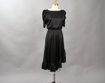 vintage 70s black dress . full skirt, puffy ruched sleeves, elastic waist 1970s dress with silver ruffles, asymmetric hem, womens size small