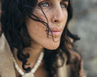 Small Tribal Gold nosering ~ 9 karat