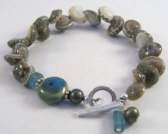 She Sells Seashells.. Natural shell, apatite and ceramic bracelet, sterling silver