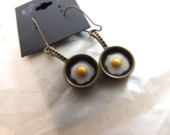Fried sunny side up Eggs in a frying pan   Earrings