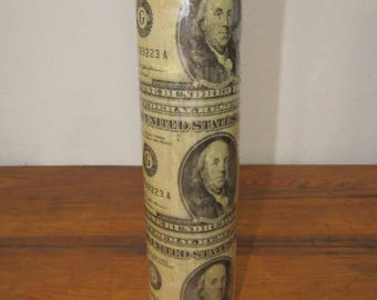 paper log covered in 100 dollar bills for burning dated 1981