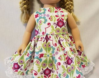 "Colorful and bright floral doll dress made to fit American Girl dolls and other similar 18"" inch dolls."
