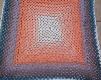 Handmade crocheted peach,  purple and green baby blanket