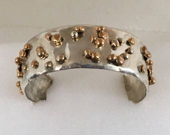Sterling silver cuff bracelet with gold plated brass and sterling silver nuggets